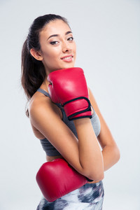 Happy beautiful girl with boxing gloves