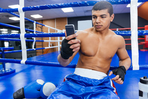 Boxer using smartphone