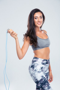 Sports woman holding skipping rope