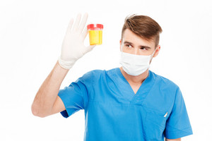 Male doctor holding bottle of urine sample