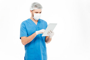 Male surgeon using tablet computer
