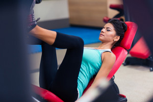 Woman workout on exercises machine at fitness gym