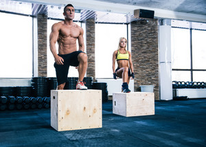 Group of man and woman working out with fit box