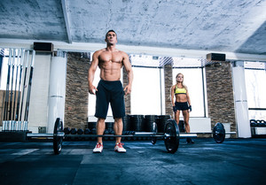 Fit man and woman workout at gym