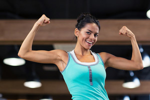 Sports woman showing her biceps