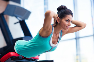 Woman workout on exercises machine