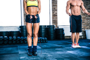 Man and woman workout with jumping rope
