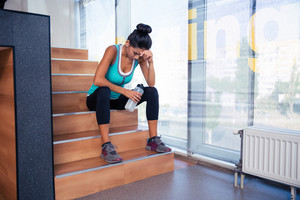 Tired woman sitting on the stairs