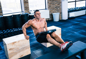 Muscular man workout at crossfit gym
