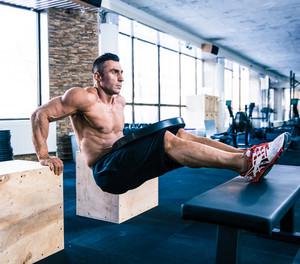 Muscular man workout at gym