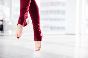 Beautiful slim legs of sportswoman in the air