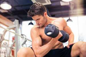 Man workout with dumbbell at gym