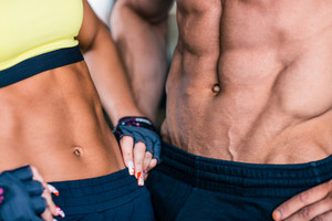 Muscular man's and sporty woman's torso
