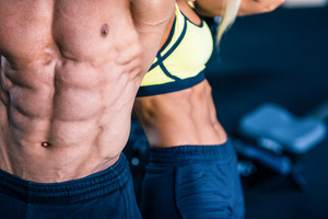 Muscular man's and strong woman's torso