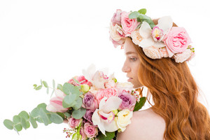 Redhead woman standing with flowers
