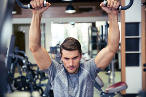 Handsome man workout in fitness gym