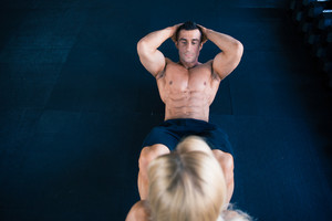 Muscular man doing abs exercise