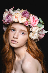 Attractive sensual woman with long wavy hair in rose wreath