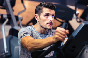 Man workout on a fitness machine at gym