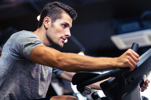 Man workout on a fitness machine