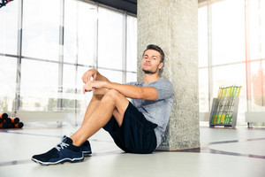Man resting on the floor at gym