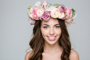 Smiling woman with wreath from flowers on head