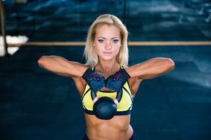 Woman workout with kettle ball in gym