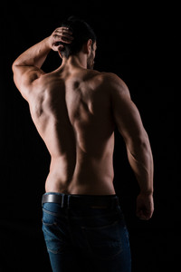 Back view portrait of athletic man