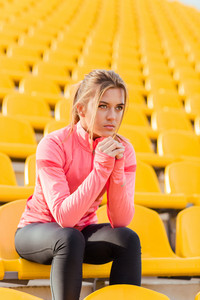 Sports woman resting at stadium
