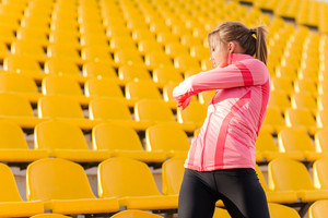 Fitness woman warming up at stadium