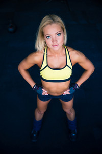 Young fitness woman looking at camera
