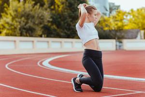 Female runner straightens her hair