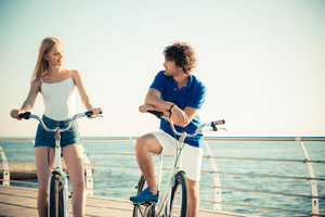 Woman and man on bicycle talking outdoors