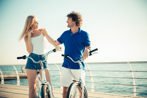 Woman and man on bicycle flirting outdoors