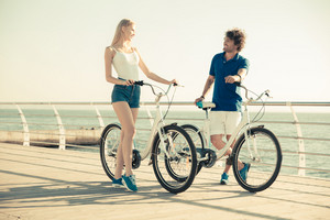 Woman and man on bicycle talkign outdoors