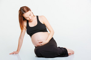 Pregnant woman sitting on the floor