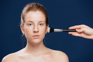 Woman with cosmetic brush