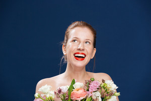 Laughing woman holding flowers
