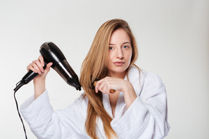 Attractive woman drying her hair