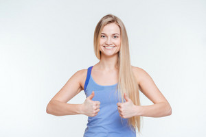 Smiling attractive woman showing thumbs up