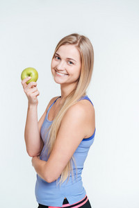 Happy sports woman holding apple