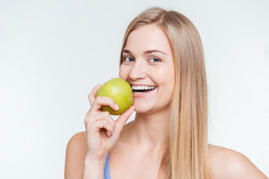 Cheerful woman holding apple