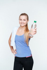 Happy sports woman holding bottle with water