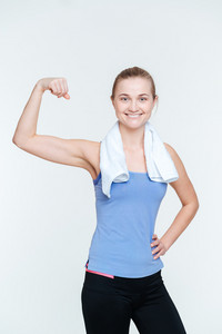 Happy fit woman showing her biceps