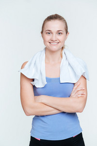 Smiling woman standing with arms folded