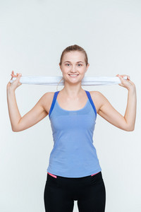 Happy fitness woman holding towel