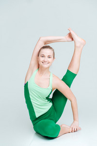 Smiling woman doing yoga exercise