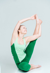 Happy woman stretching leg