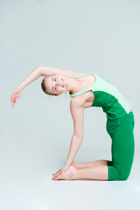 Happy woman doing yoga exercise