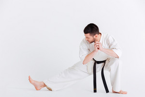 Young man in kimono stretching